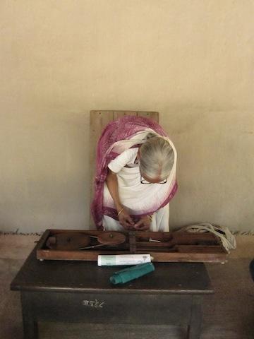 Spinning cotton fiber into khadi cloth at Sevagram Ashram.